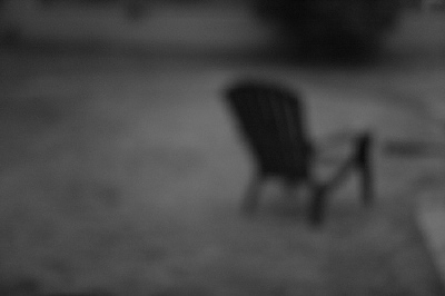 chair in rain at dusk by kevindooley