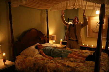 Cotton Marcus exorcising Nell from the Lionsgate film The Last Exorcism
