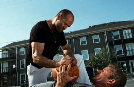 Jason Statham stabbing a guy in the ball from the Lionsgate film The Expendables
