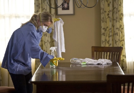 Corinne cleaning the table from the New Line Cinema film Going the Distance