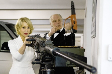 Victoria and Marvin with the huge gun from the Summit Entertainment film Red