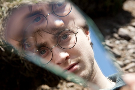 Harry stares into the mirror shard from the Warner Bros. Pictures film Harry Potter and the Deathly Hallows Part 1