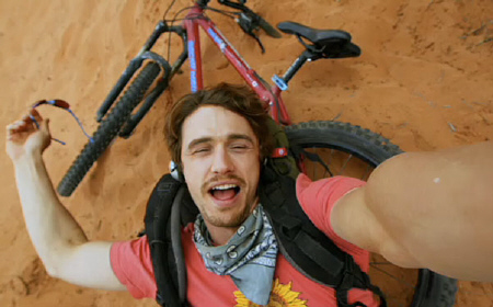 Aron falls off his bike in the Film4 Film 127 Hours