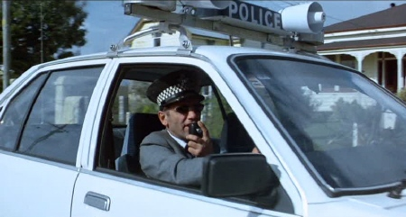 Zac in a police car from the film The Quiet Earth
