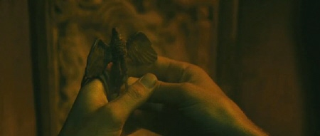 Marcus has a carved eagle from the Focus Features film The Eagle