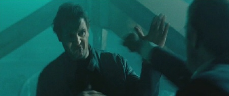 martin punches a bad guy from the Dark Castle Entertainment film Unknown