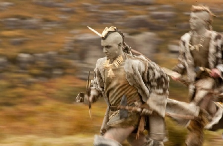 a painted warrior running from the Focus Features film The Eagle