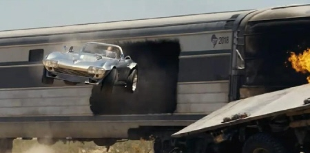 car driving out of train from the Universal Pictures film Fast Five