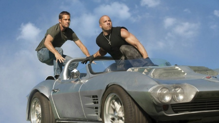 Brian and Dominic jump out of a car from the Universal Pictures film Fast Five