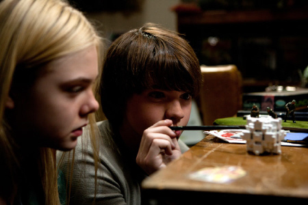 Alice and Joe poke the white rubiks cube from the Paramount Pictures film Super 8