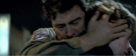 Joe and his dad hug from the Paramount Pictures film Super 8