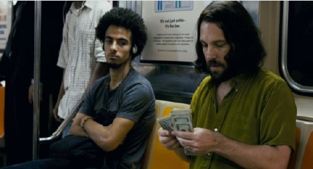 Ned counts money on the subway from the movie Our Idiot Brother