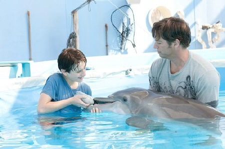 Sawyer and Clay feed Winer from the Warner Bros. Pictures film Dolphin Tale