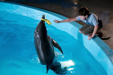 Winter plays with Sawyer from the Warner Bros. Pictures film Dolphin Tale