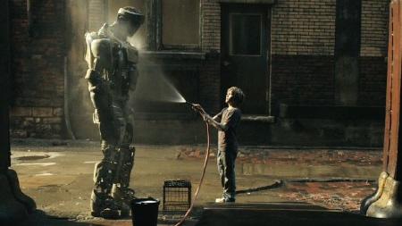 Dakota Goyo gives Atom a bath from the Walt Disney Studios film Real Steel