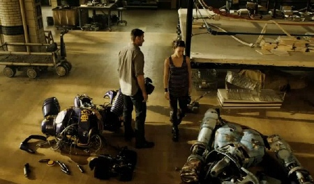 Hugh Jackman and Evangeline Lily survey broken robots from the Walt Disney Studios film Real Steel