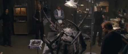 scientists dissect the alien from the Universal Pictures film The Thing 2011