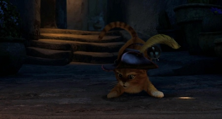 Puss chases a spot of light from the Dreamworks film Puss in Boots