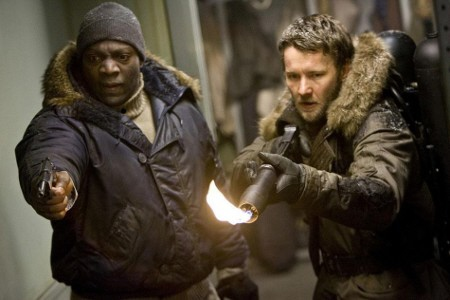 Joel Edgarton and Adewale Akinnuoye-Agbaje defending themselves from the Universal Pictures film The Thing 2011