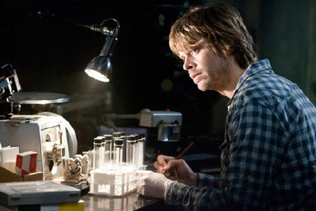 Eric Christian Olsen doing a blood test from the Universal Pictures film The Thing 2011