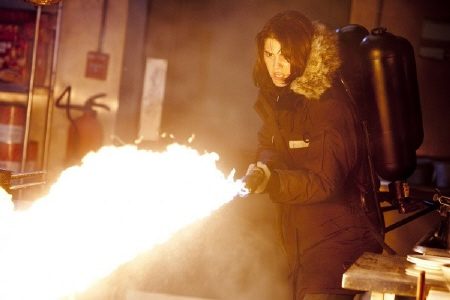 Mary Elizabeth Winstead with a flame thrower from the Universal Pictures film The Thing 2011