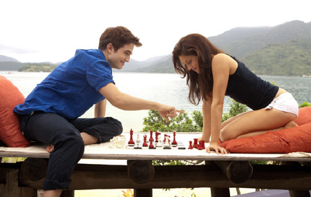 Edward and Bella play chess on their honeymoon from the Summit Entertainment film Breaking Dawn Part 1
