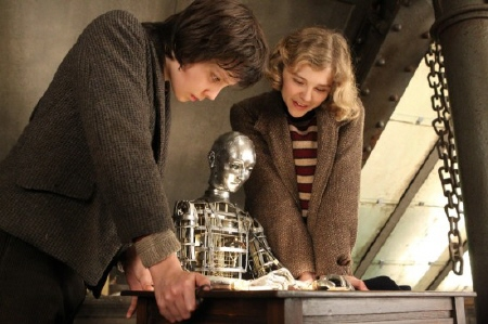 Asa Butterfield and Chloe Moretz with the automaton from the GK Films movie Hugo
