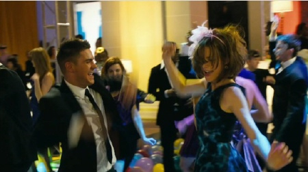 Zac Efron and Michelle Pfeiffer dance from the New Line Cinema film New Years Eve