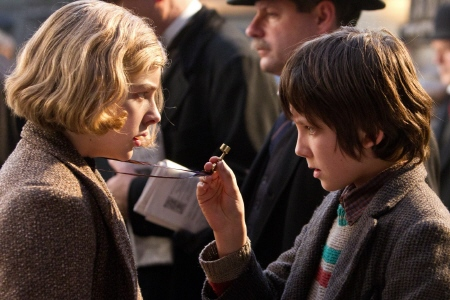 Chloe Moretz and Asa Butterfield stare at the key from the GK Films movie Hugo