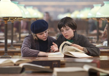 Chloe Moretz and Asa Butterfield read a book from the GK Films movie Hugo