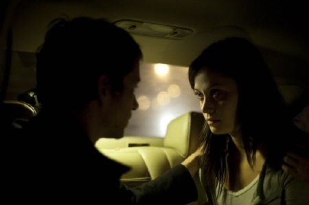 Ben exorcises Isabella in the car from the film The Devil Inside
