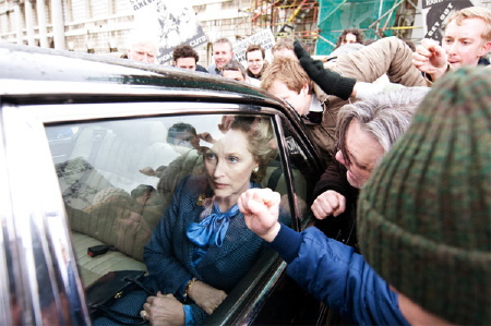 Thatchers critics bang on her car windows from the Film 4 movie The Iron Lady