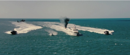 Navy helicopters and ships take a yacht from the Bandito Brothers film Act of Valor
