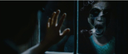 face in the window from the CBS Films movie The Woman in Black