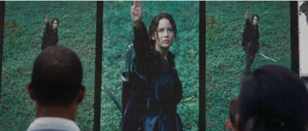 Katniss gives her salute from the Lionsgate film The Hunger Games
