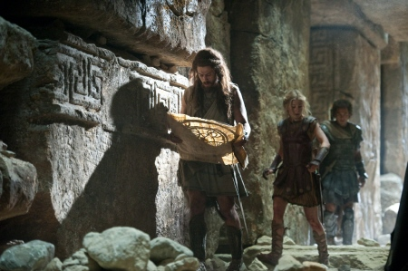 Toby Kebbel, Rosamund Pike, and Sam Worthington from the Warner Bros. Pictures film Wrath of the Titans