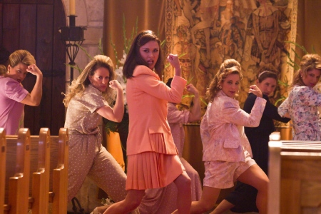 Catherine Zeta Jones leads a posse of church ladies in the Warner Bros. Pictures film Rock of Ages