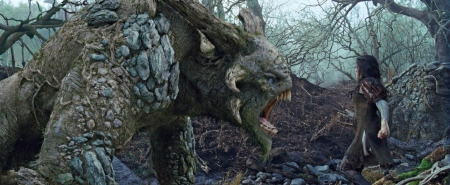 Snow White faces down a troll from the Universal Pictures film Snow White and the Huntsman