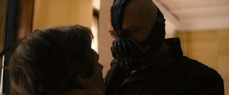 Bane snaps the neck of his goon from the Legendary Pictures film Dark Knight Rises