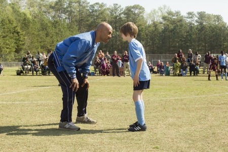 Common teaches Timothy how to play soccer from the Disney film the Odd Life of Timothy Green