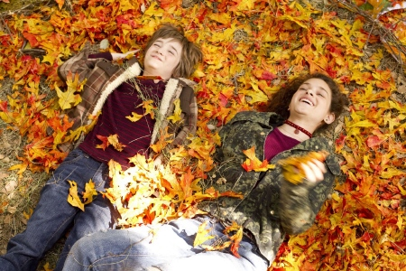 Timothy and Joni play in leaves from the Disney film the Odd Life of Timothy Green
