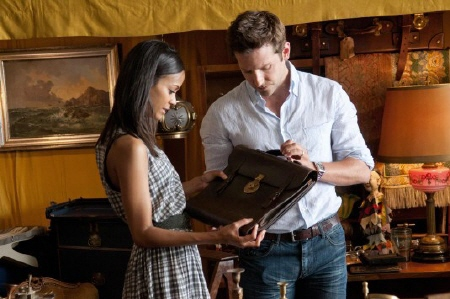 Zoe Saldana and Bradley Cooper with the old briefcase from the CBS Films movie The Words