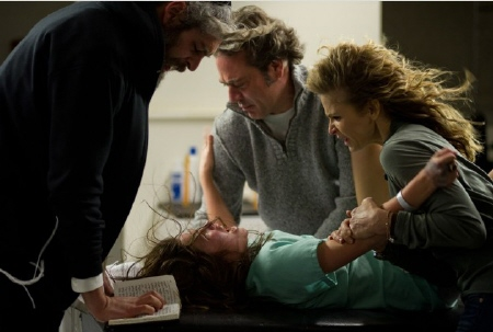 Jeffrey Dean Morgan and Kyra Sedgwick help with the exorcism from the Ghost House Pictures film The Possession