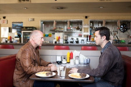 Old Joe and Young Joe have lunch from the Endgame Entertainment film Looper