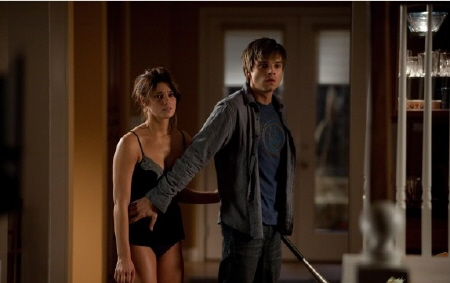 Sebastian Stan protects Ashley Green in her underwear from the Dark Castle Entertainment film The Apparition
