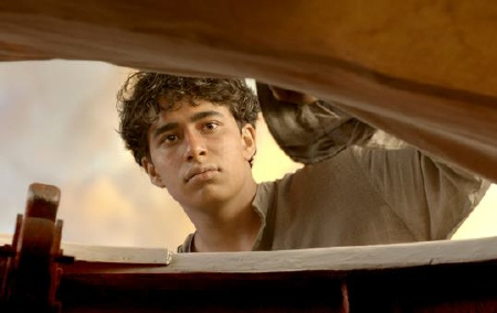 Pi peeks inside the life boat from the Fox 2000 Pictures film Life of Pi