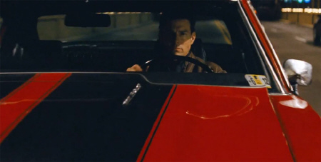 Tom Cruise drives a muscle car from the Paramount Pictures film Jack Reacher