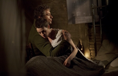 Jean Valjean comforts Fantine from the Universal Pictures film Les Miserables