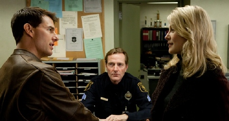 Tom Cruise and Rosamund Pike at the police station from the Paramount Pictures film Jack Reacher