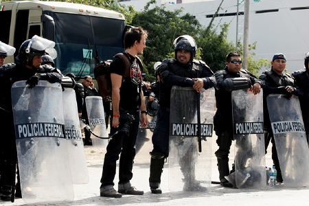 Rob Stewart talks to the Mexican police from the documentary Revolution